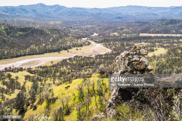 view down mountain with rock formation, forest and meadow in henry w. coe state park - koeberer stock photos and pictures