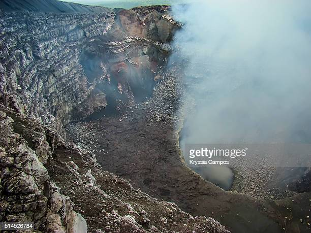 view down of crater of the masaya volcano. - masaya volcano stock pictures, royalty-free photos & images