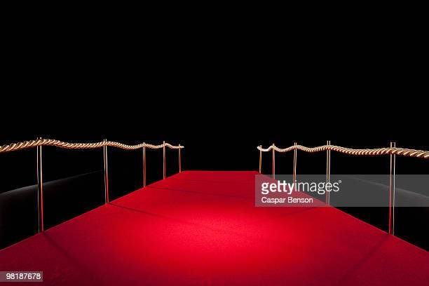 View down red carpet with rope barriers