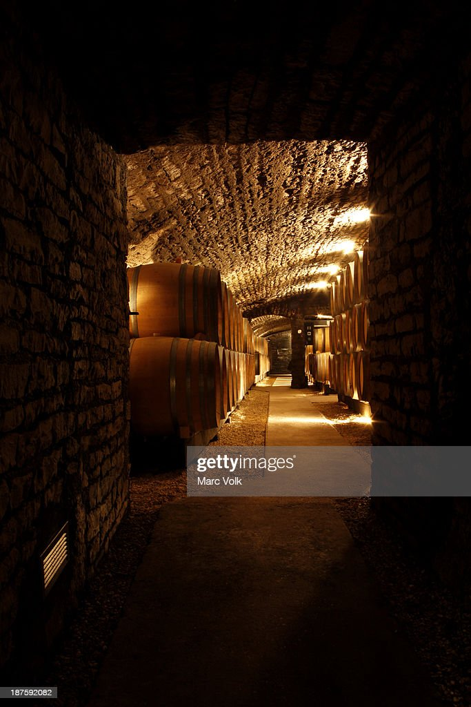 View down the corridor of a wine cellar : Stock Photo