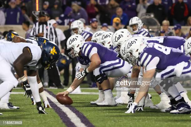 View down the line of scrimmage in the fourth quarter of a Big 12 football game between the West Virginia Mountaineers and Kansas State Wildcats on...