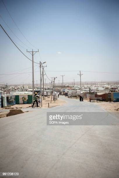 View down the main road of Zaatari refugee camp There are about 14 million Syrian refugees in Jordan and only 20 percent are living in the refugee...
