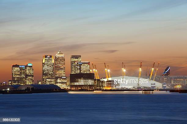 A view down the river Thames towards the City of London and the O2 Arena and Canary Wharf at sunset