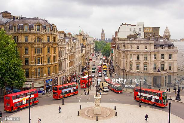 view down whitehall of buses and big ben - trafalgar square stock pictures, royalty-free photos & images