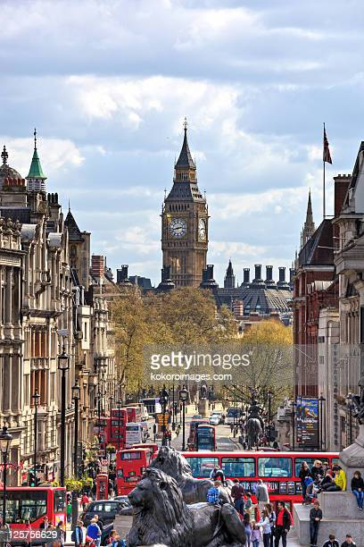 view down whitehall with big ben and red buses - whitehall london stock pictures, royalty-free photos & images
