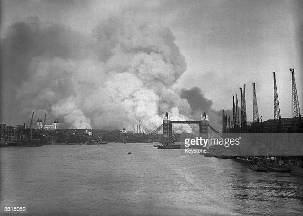 A view east down the Thames towards smoke rising from fires in Surrey docks following the first German air raid of the London Blitz 7th September...