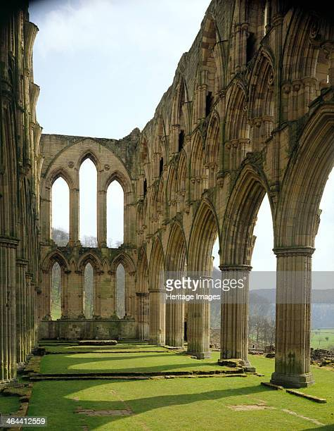 View eastwards along the chancel of the church at the Cistercian monastery of Rievaulx Abbey, North Yorkshire, 1994. The distant moors of the...