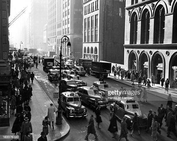 View facing south at the intersection of 41st Street and Madison Avenue New York City 1940s
