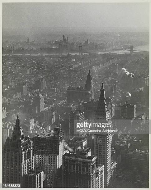 View facing Southeast from the Empire State Building An unknown building is under construction in the foreground The tower and clock of the...