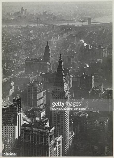 View facing Southeast probably from the Empire State Building A building is under construction in the foreground The tower and clock of the...