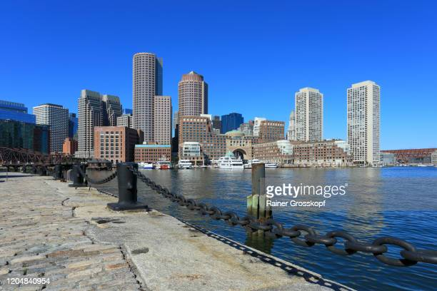 view fom fan pier across the water at the skyscrapers of boston harbor - rainer grosskopf stock pictures, royalty-free photos & images