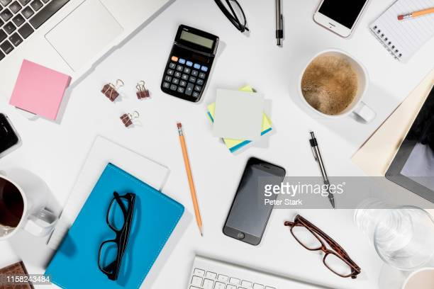 view form above belongings on messy desk - 文房具 ストックフォトと画像