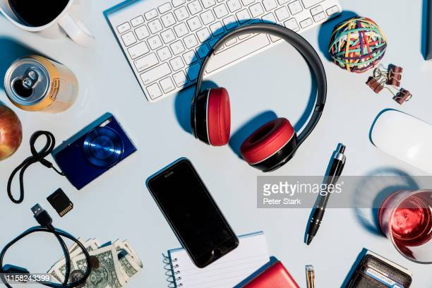 view form above headphones, smart phone, digital camera and office supplies on desk - flat lay stock pictures, royalty-free photos & images