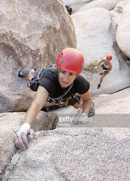 view form above of female rock climbers at joshua tree - joshua tree stock photos and pictures