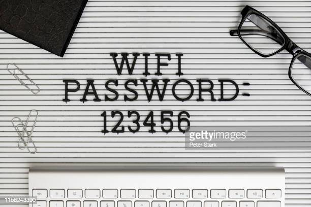 "view form above ""wifi password 123456"" on desk above computer keyboard - password stock pictures, royalty-free photos & images"