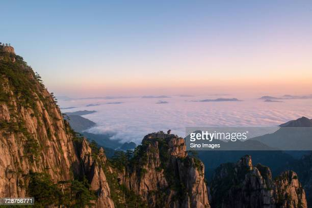 View form rocky mountain towards valley, Mount Huangshan, Anhui, China