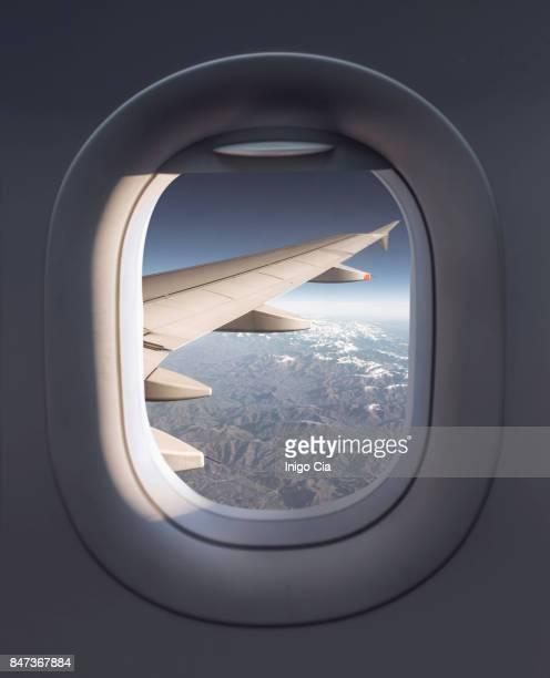 view from a airplane - ventana fotografías e imágenes de stock