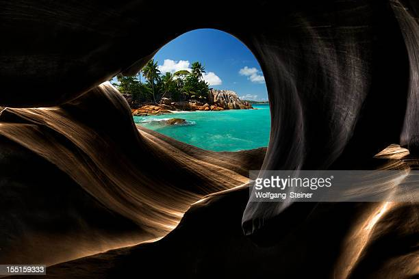 view from a cave - la digue island stock pictures, royalty-free photos & images