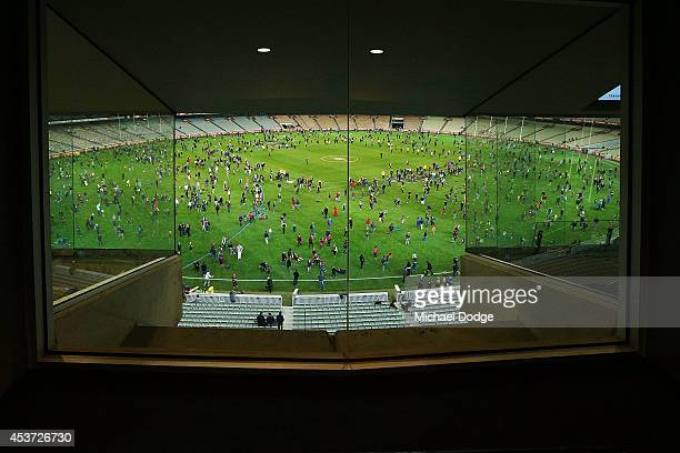 A view from a corporate box is seen as fans have kick to kick on the ground after the round 21 AFL match between the Melbourne Demons and the Greater...