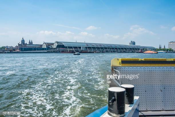 View from a ferry in Amsterdam over the IJ near Amsterdam Central Station.