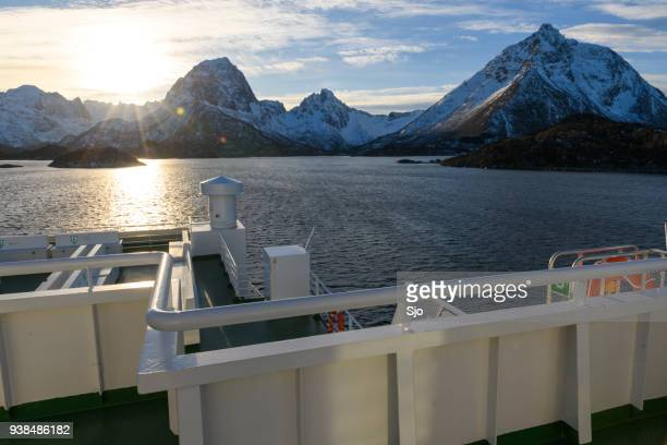 """view from a ferry on the lofoten islands in northern norway in winter - """"sjoerd van der wal"""" or """"sjo"""" stock pictures, royalty-free photos & images"""