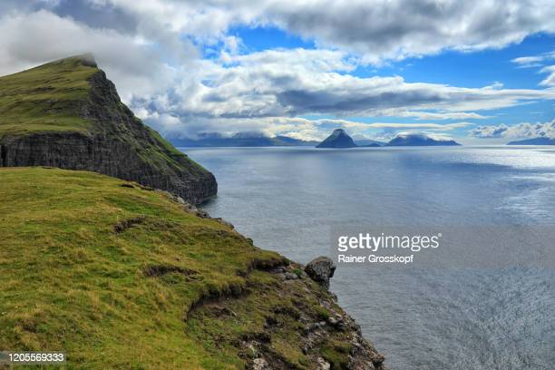 view from a grassy mountain at the atlantic ocean with several islands in the distance - rainer grosskopf stock-fotos und bilder