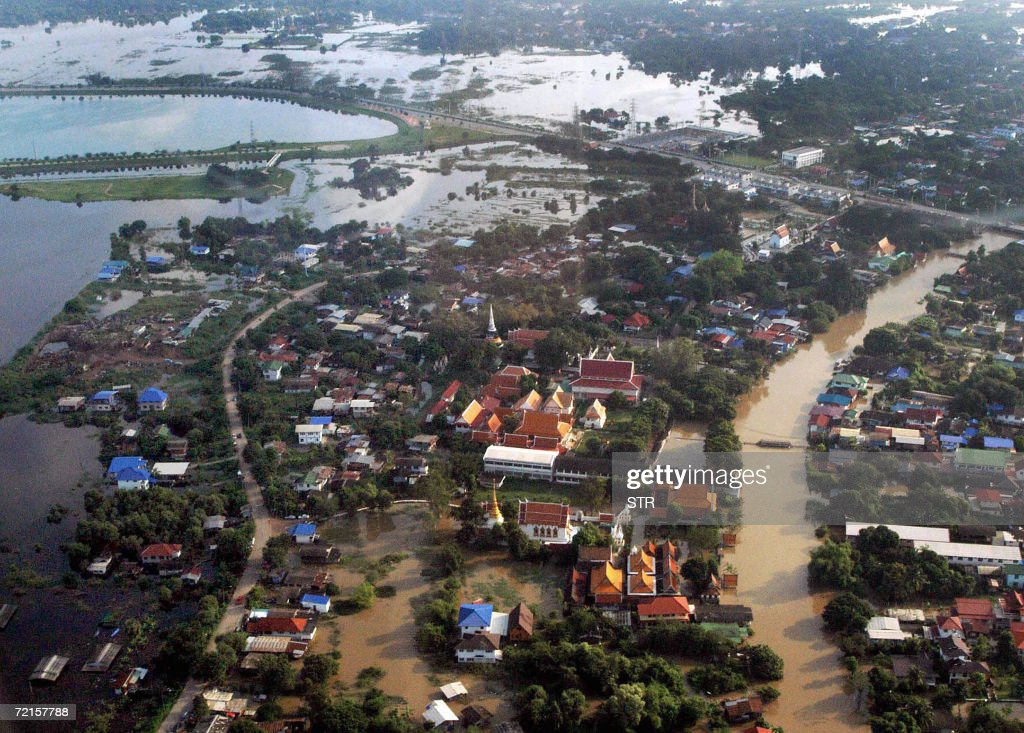 A view from a helicopter shows the flood area caused by heavy rain in the wake of Typhoon Xangsane in Ayutthaya province northern of Thailand, 13 October 2006. The death toll from severe flooding across Thailand rose to 47, the government said, even as waters began to recede in northern provinces.