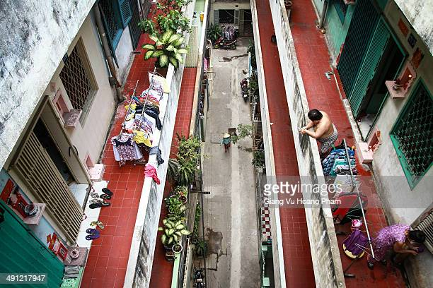 CONTENT] View from a high corridor inside a condominium in Chinatown Cholon Saigon