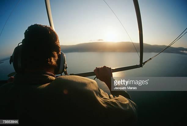 a view from a microlight as the sun rises over the horizon - aereo ultraleggero foto e immagini stock