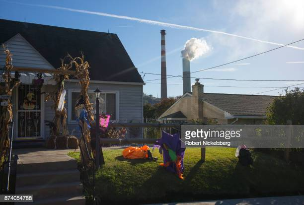 A view from a residential area of the smoke stack of the 47year old Cheswick coalfired power plant October 27 2017 in Springdale Pennsylvania Local...