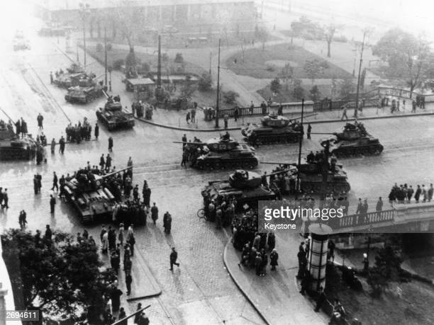 A view from a tall building of a convoy of Soviet heavy tanks stationed at strategic points in the centre of Budapest during the anticommunist...