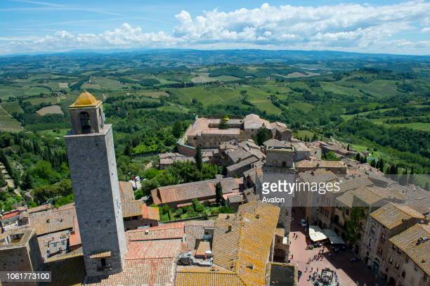 View from a tower of the medieval walled hill town of San Gimignano in Tuscany, Italy and the surrounding landscape.