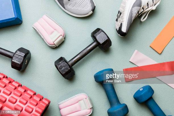 view from above dumbbells and exercise equipment - knolling - man made object stock pictures, royalty-free photos & images