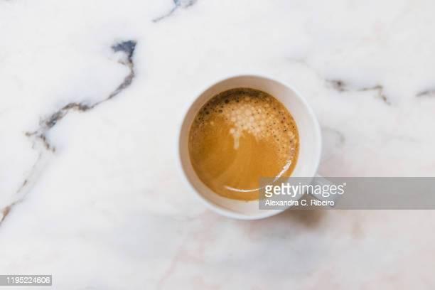 view from above espresso in mug on marble surface - caneca imagens e fotografias de stock