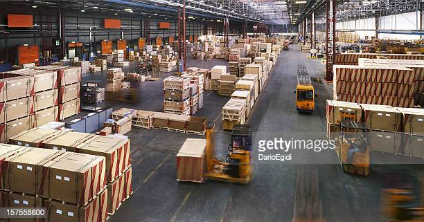 View from above inside a busy huge industrial warehouse