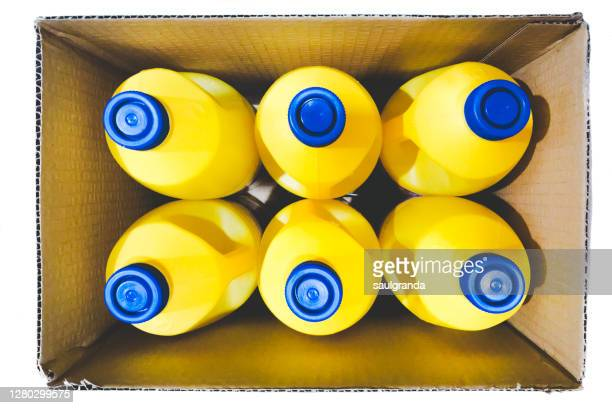 view from above of a box with six bottles of bleach - bleach stock pictures, royalty-free photos & images