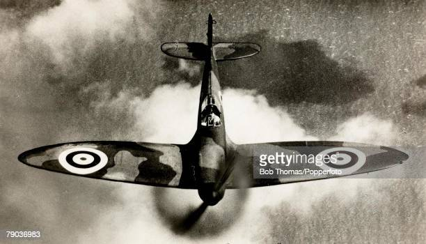 View from above of a British Supermarine Spitfire singleseat fighter aircraft of the Royal Air Force in flight circa 1940 The Spitfire made it's name...