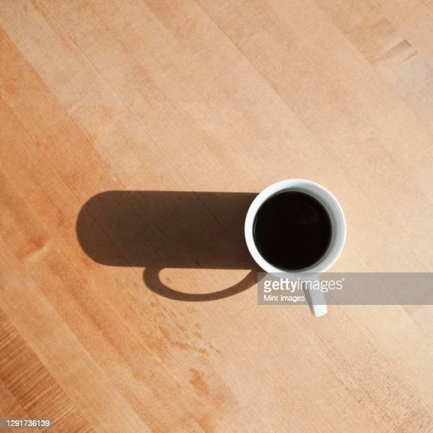 view from above of black coffee in a mug. - kitchen worktop stock pictures, royalty-free photos & images