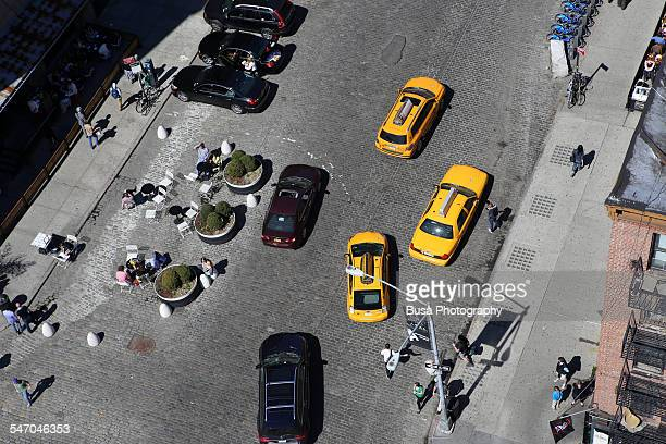 View from above of cabs and cars