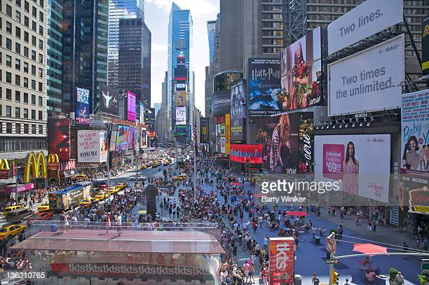 view from above of crowded nyc intersection. - times square manhattan stock pictures, royalty-free photos & images