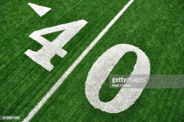 view from above of forty yard line on american football field - forty yard line stock pictures, royalty-free photos & images