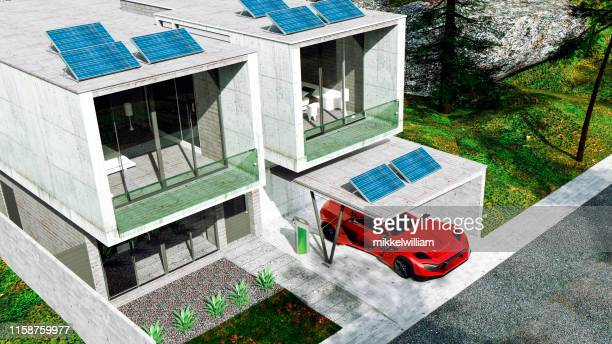 View from above of house with solar panels that are used to power the home and an electric car