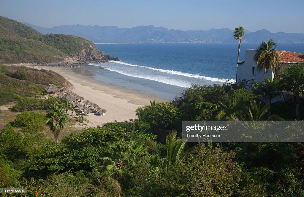 View from above of palapas on a beach at Tenacatita Bay, Costalegre, Jalisco, Mexico : Stock Photo