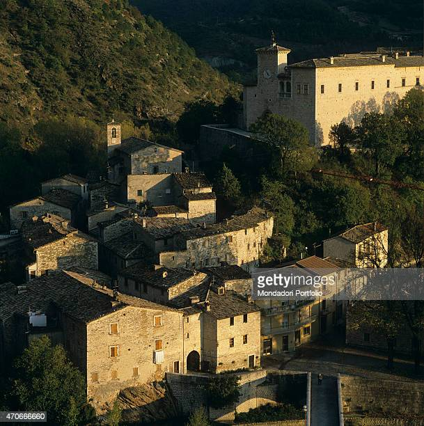"""View from above of Piobbico, small hilly town in the region Marche, dominated by the Brancaleoni castle, known as Palazzo De' Conti, built as a..."