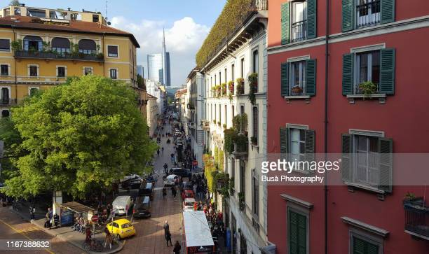 view from above of residential buildings in via solferino, in the fashionable district of brera, milan, italy - milan stock pictures, royalty-free photos & images