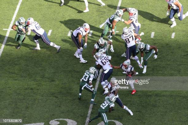 View from above of Running Back James White of The New England Patriots running against the New York Jets during their game at MetLife Stadium on...