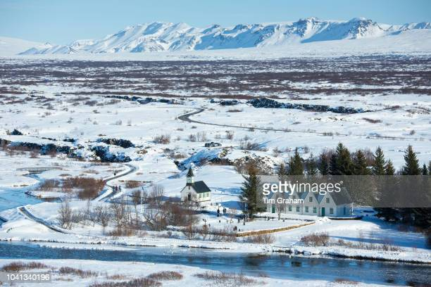 View from above of snowcovered famous tourist sight Thingvellir National Park Pingvellir church and summer residence of Prime Minister of Iceland