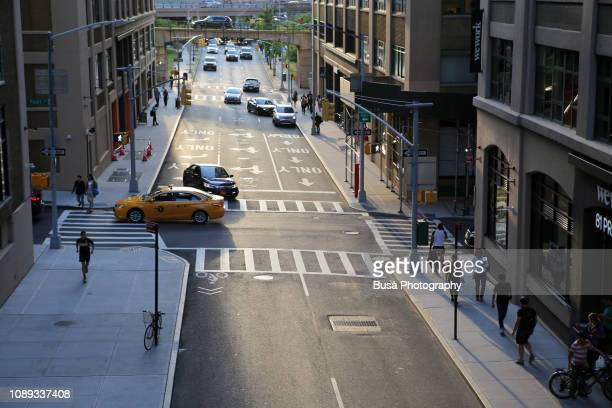 view from above of traffic in streets of dumbo, brooklyn, new york city, usa - road junction stock pictures, royalty-free photos & images