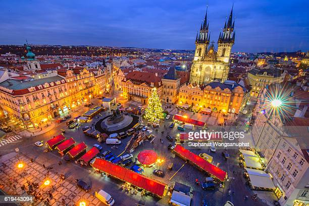 View from above on traditional Christmas market at Old Town Square illuminated and decorated for holidays in Prague - capital of Czech Republic.