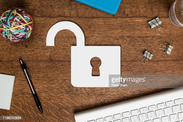 view from above paper padlock on wooden desk - vulnerability stock pictures, royalty-free photos & images